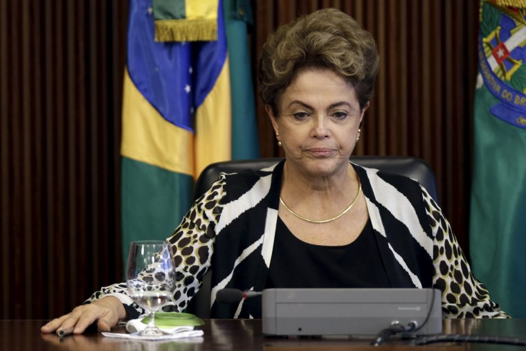 Image: Brazil's President Dilma Rousseff reacts during a meeting with ministers at the Planalto Palace in Brasilia