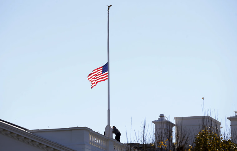 Image: The flag over the White House is lowered to half staff to honor the victims of the San Bernardino, California shootings.