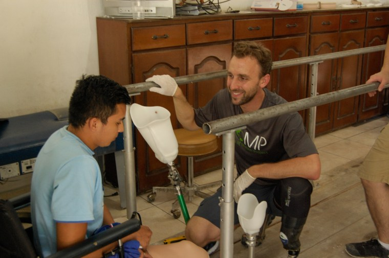 Dave Krupa works with a bilateral patient in the Zacapa clinic in Guatemala. This is a particularly difficult case, as his left leg was amputated above the knee, and his right leg was amputated below the knee.