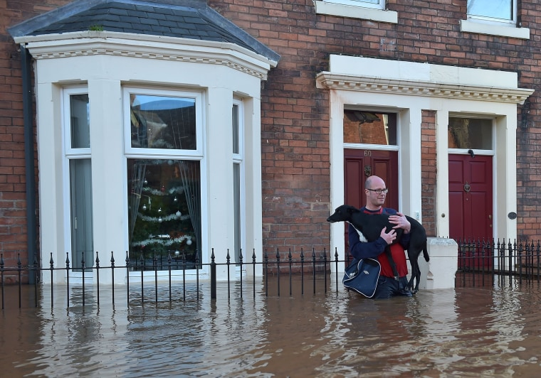 Image: Residents leave their homes