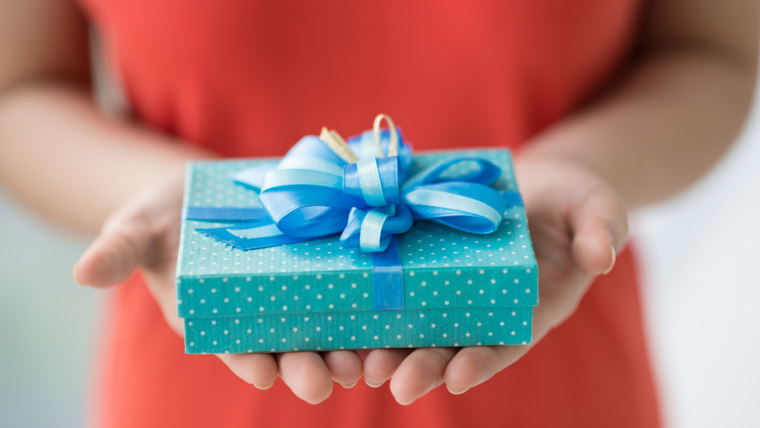 Close-up of female hands holding a present; Shutterstock ID 142656325; PO: today.com