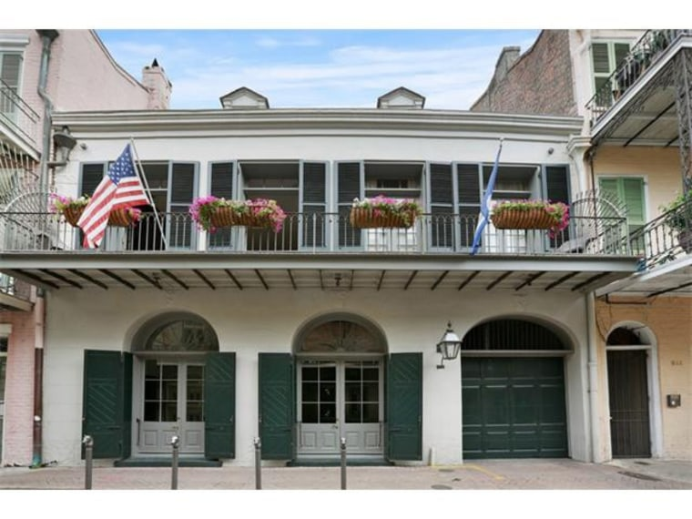 Brad Pitt and Angelina Jolie lower listing price of New Orleans home.