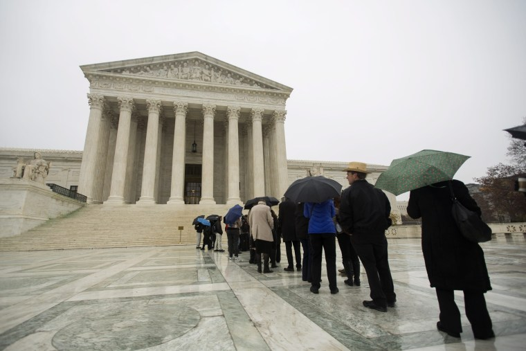 Visitors line up outside the Supreme Court