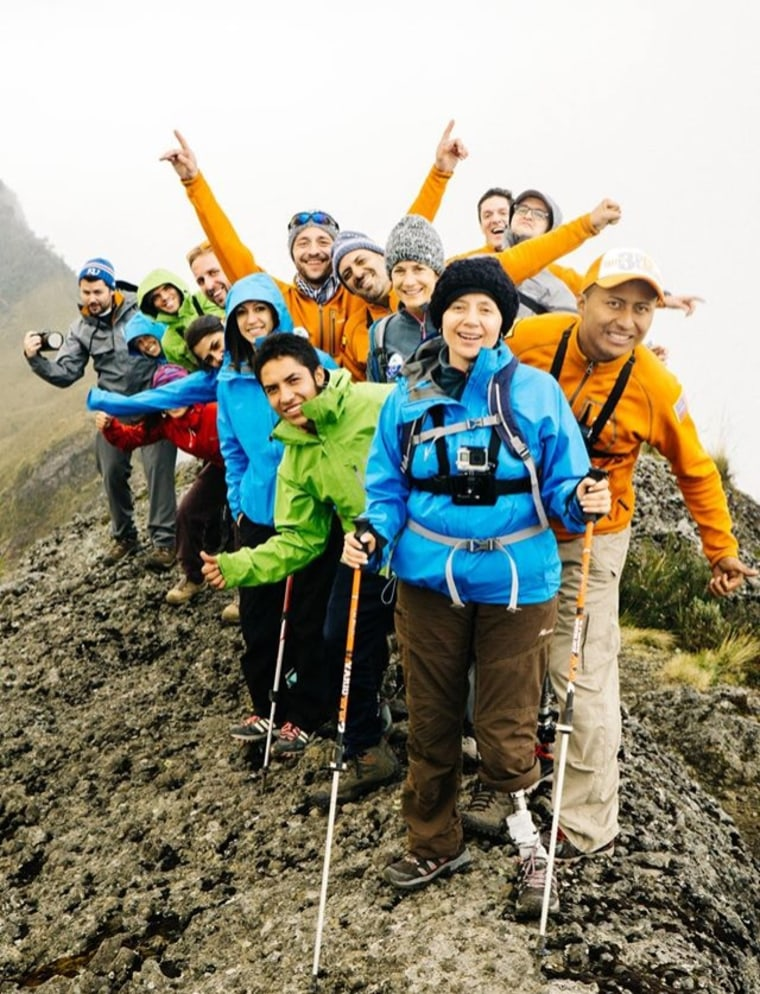 The entire Climbing for ROMP team smiles behind team member Kathy Pico after having reached the summit of Pasochoa (13,780ft).