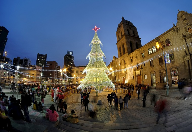 Image: An illuminated Christmas tree is displayed in front of San Francisco church in La Paz