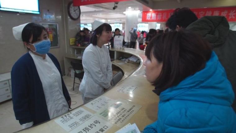 Image: Worker at Beijing Children's Hospital