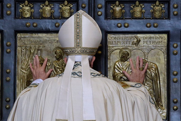 Pope Francis pushes open the Holy Door of St. Peter's Basilica, formally launching the Holy Year of Mercy, at the Vatican on Tuesday, Dec. 8, 2015.