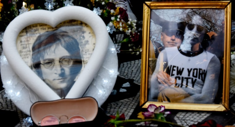 Image: A man is reflected in a picture as people gather and sing songs by John Lennon