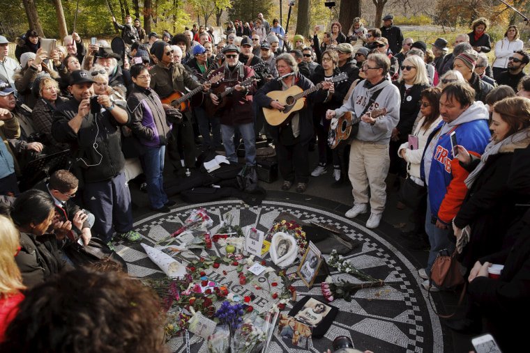 Image: Fans of former Beatle Lennon gather at the Imagine mosaic in the Strawberry Fields section of New York's Central Park to mark the 35th anniversary of his death, in New York