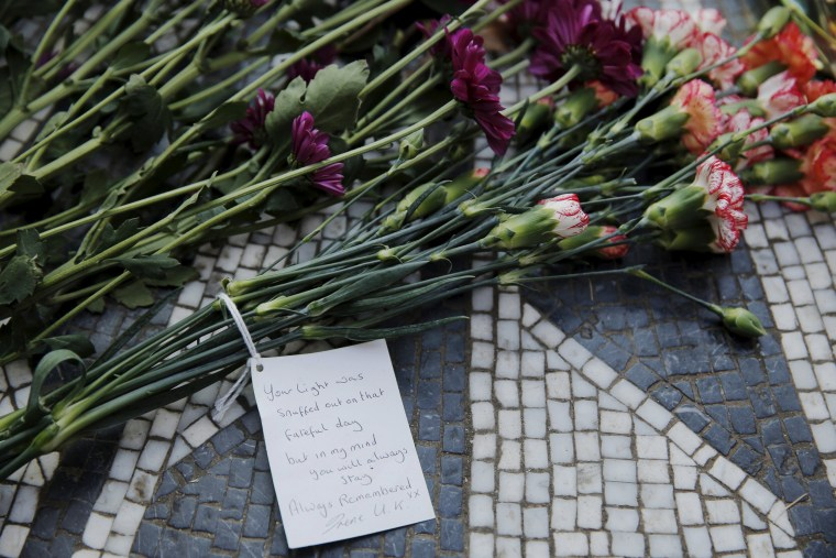 Image: Flowers lay at the Imagine mosaic in the Strawberry Fields section of New York's Central Park to mark the 35th anniversary of John Lennon's death, in New York