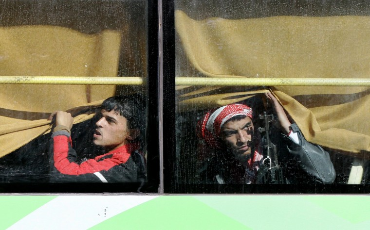 Image: Syrian rebel fighters are seen on a bus