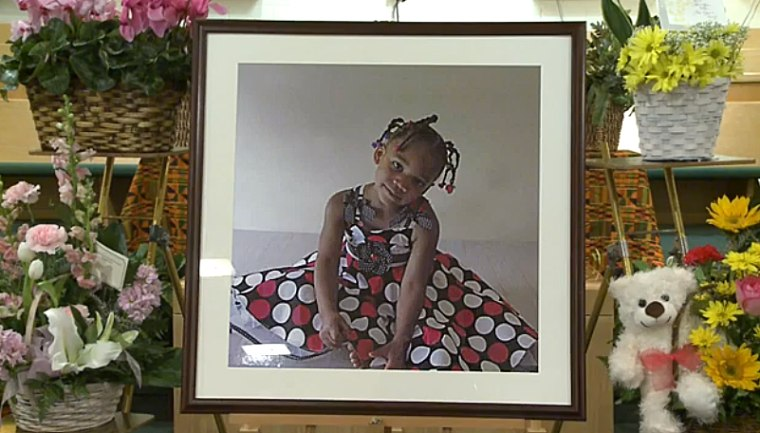 A photo of five-year-old Payton Benson is displayed at her funeral.