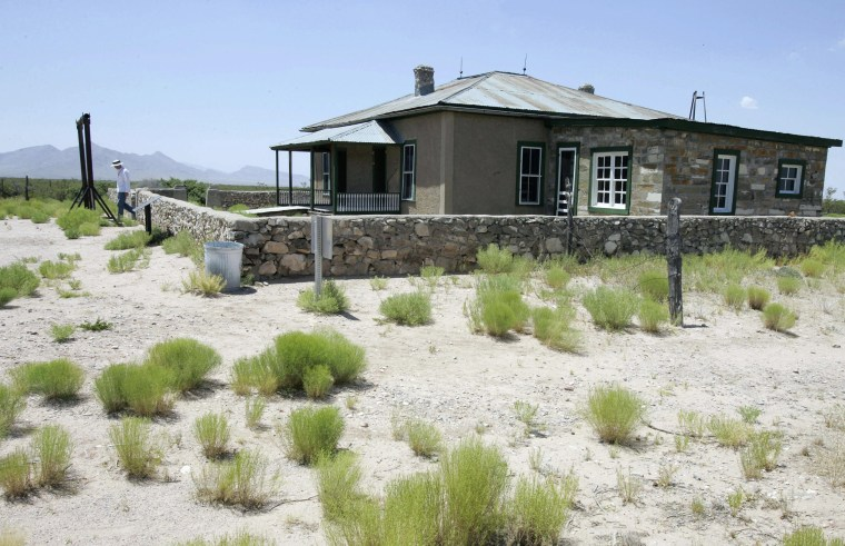 Image: A visitor leaves the McDonald Ranch House at Trinity Site