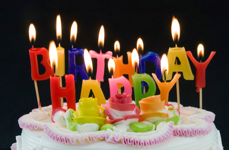 Image: Candles flicker on a birthday cake