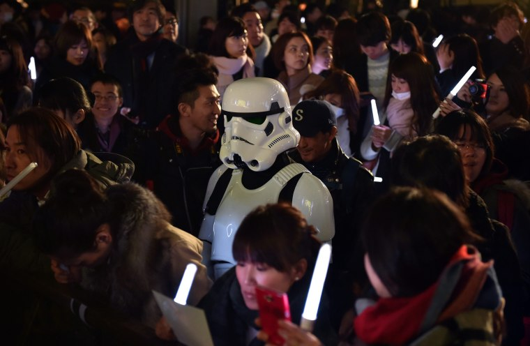 Image: A fan dressed as a Stormtrooper at a promotional event in Tokyo