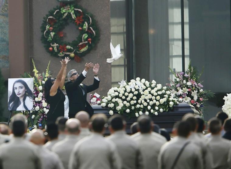 Image: Parents of San Bernardino shooting victim Velasco release a white dove over her casket during memorial service in Covina
