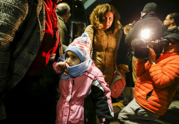 Image: Syrian refugees arrive at a hotel in Mississauga, Ontario