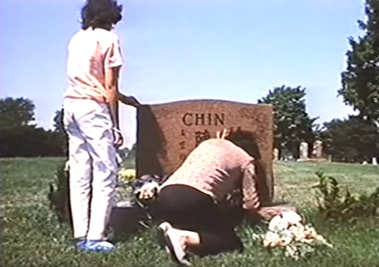 "This screenshot from the documentary ""Who Killed Vincent Chin?"" shows Chin's family at his grave."