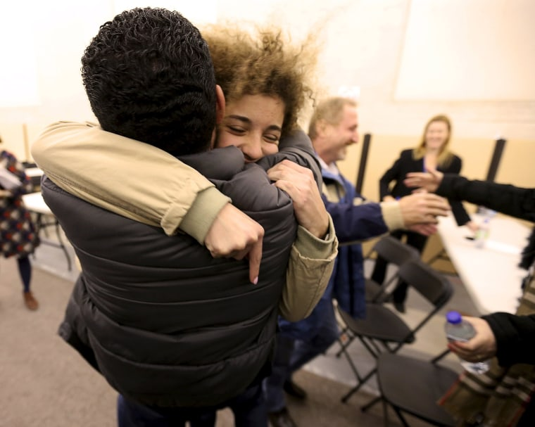 Image: Anas Francis is reunited with his cousin Syrian refugee Laila Beylouneh at the Welcome Centre in Montreal