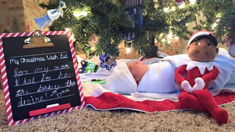 Siblings get a new baby brother under the Christmas tree