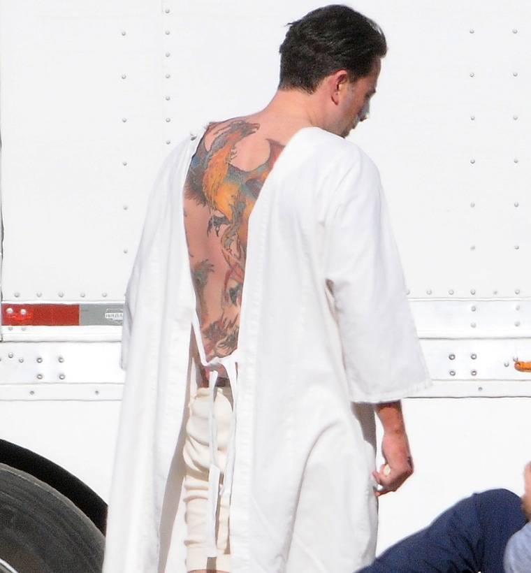 "Ben Affleck reveals huge back tattoo on the set of ""Live by Night."""