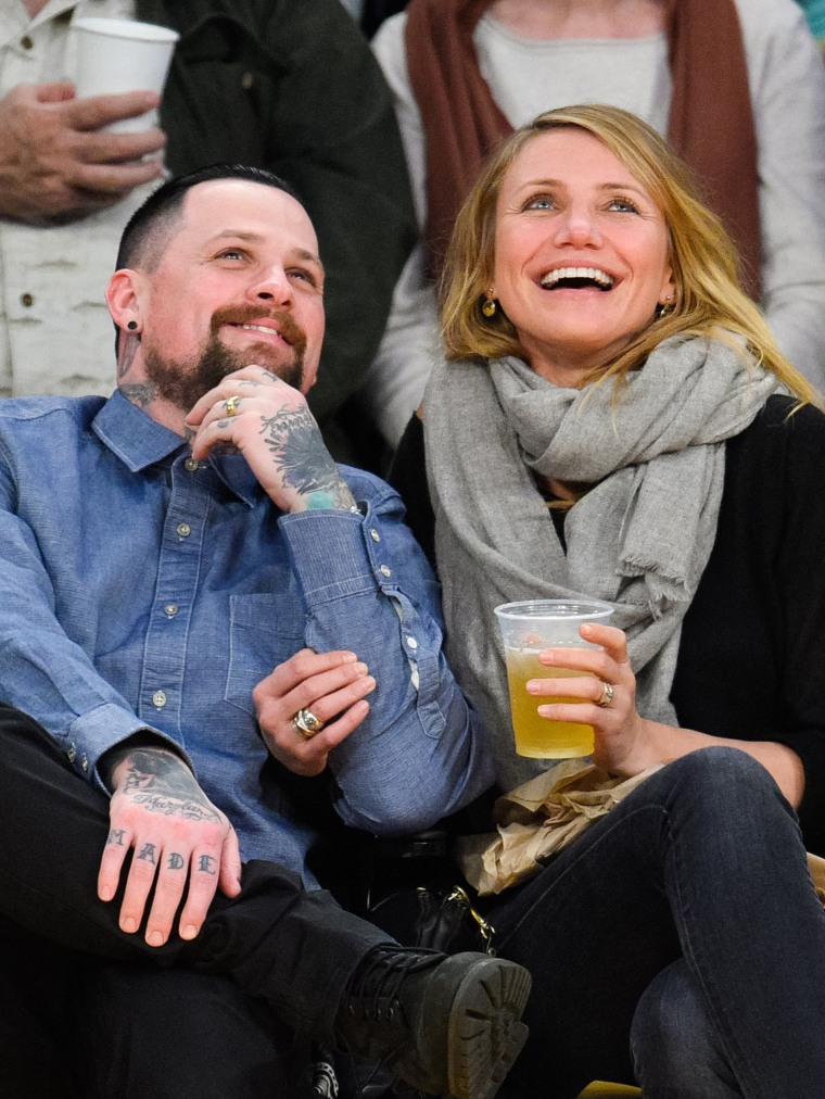 Benji Madden and Cameron Diaz attend a basketball game between the Washington Wizards and the Los Angeles Lakers