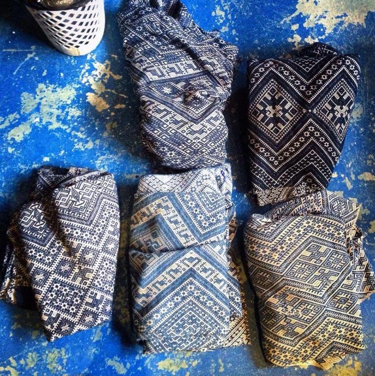 Indigo-dyed handwoven cotton damask blankets with symbolic iconography of protection.
