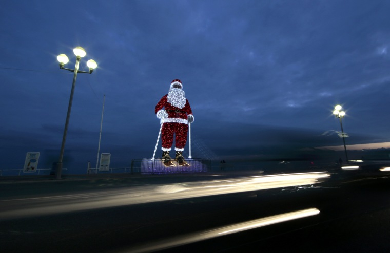 Image: A giant illuminated Santa Claus is seen on the Promenade Des Anglais as part of holiday season decorations in Nice