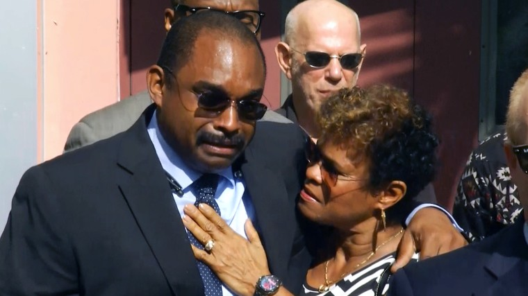 Image: Jermaine McBean's mother, Jennifer Young, and brother, Alfred McBean