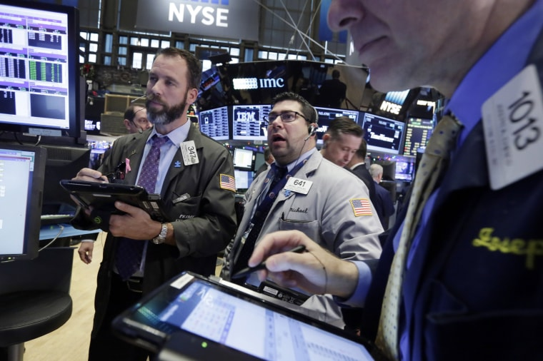 Image: Traders work the floow of the New York Stock Exchange