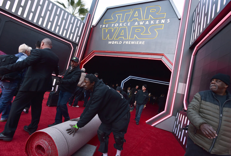 Image: Staff prepare the red carpet
