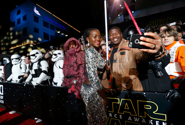 "Image: Actress Lupita Nyong'o poses with a fan as she arrives at the premiere of ""Star Wars: The Force Awakens"" in Hollywood"