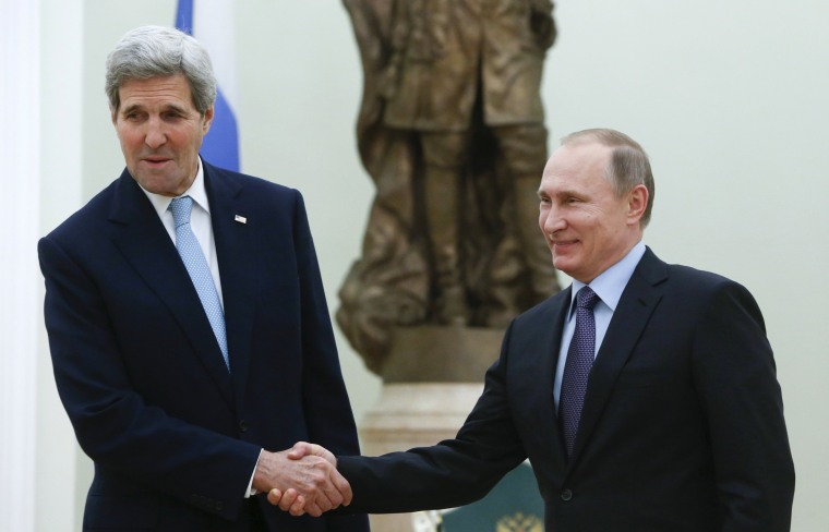 Image: Russian President Putin welcomes U.S. Secretary of State Kerry during meeting at Kremlin in Moscow