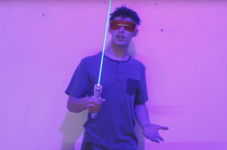 "Drake Anthony poses with his 6-watt ""laser sword."""