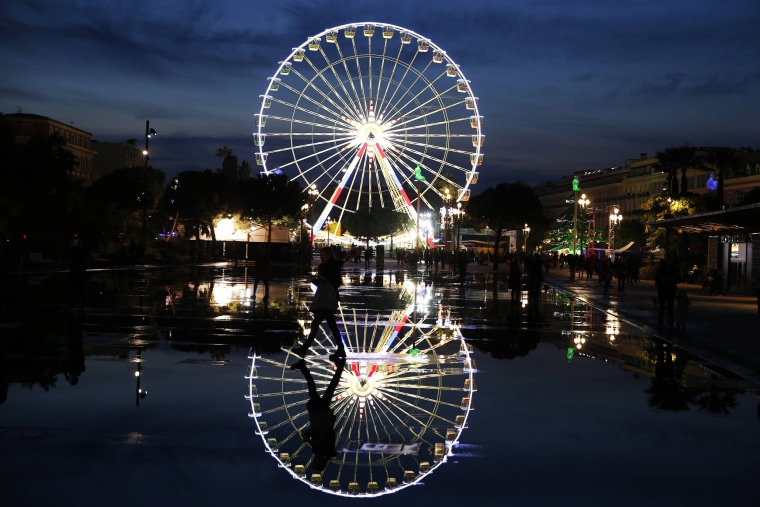 Image: FRANCE-CHRISTMAS-FERRIS-WHEEL-FEATURE