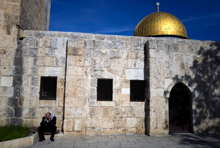 Image: A Muslim man sits outside the Harim el Sharif