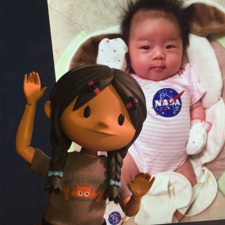 Yuna doll with Yuna the baby, a newborn whose father works at NASA.
