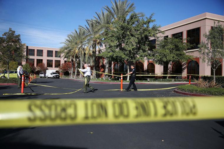 Image: Police tape in front of the Inland Regional Center in San Bernardino, California