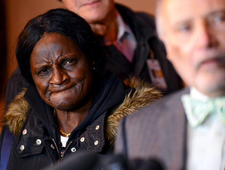 Image: Gloria Darden, mother of the late Freddie Gray, listens to media questions during a family news conference outside the courthouse in Baltimore