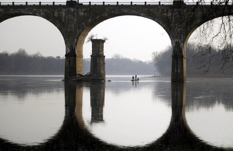 Image: People take advantage of unseasonably warm weather to fish on the Delaware River