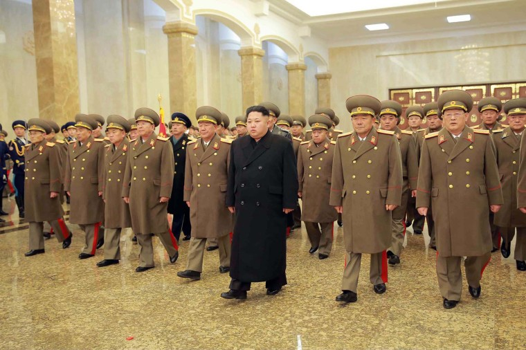 Image: North Korean leader Kim Jong-Un is accompanied by commanding officers of the Korean People's Army