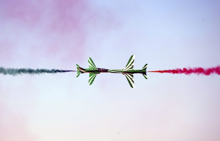 Image: Members of Royal Saudi Hawks Air Force Aerobatic team perform with Hawk planes