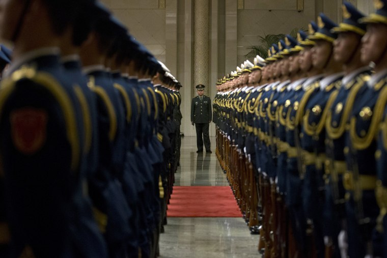 Image: Members of a Chinese honor guard prepare for a welcome ceremony for Russian Prime Minister Dmitry Medvedev