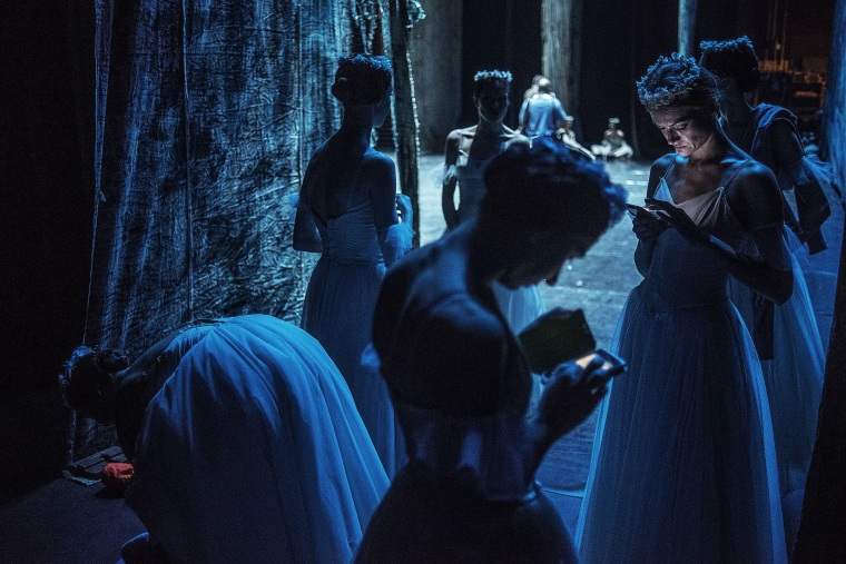 "Image: Ballerinas take a break during a ""Giselle"" dress rehearsal"