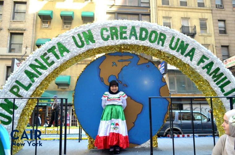 A young Latina Muslim participant in the Hispanic Day Parade, New York NY 2014.