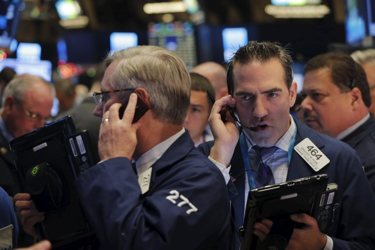 Image: Traders work on the floor of the New York Stock Exchange (NYSE) shortly after the opening bell in New York