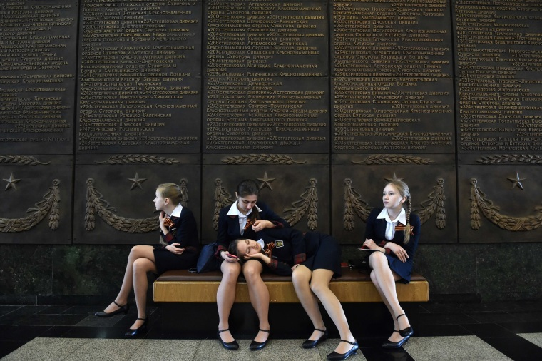 Image: Schoolgirls rest on a banquette at the Museum of the Great Patriotic War