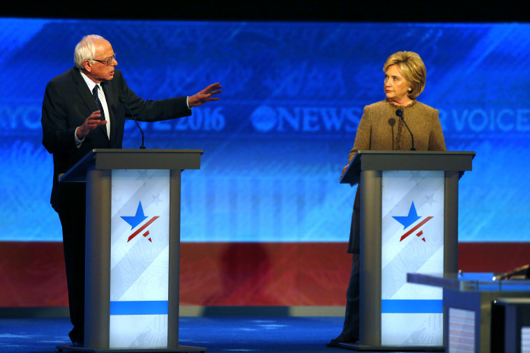 Bernie Sanders, left, offers an apology to Hillary Clinton during a Democratic presidential primary debate Saturday, Dec. 19, 2015, at Saint Anselm College in Manchester, N.H. (AP Photo/Jim Cole)