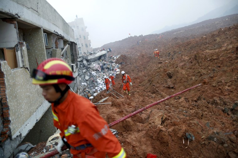 Image: Firefighters search for survivors near a damaged building at the site of a landslide at an industrial park in Shenzhen