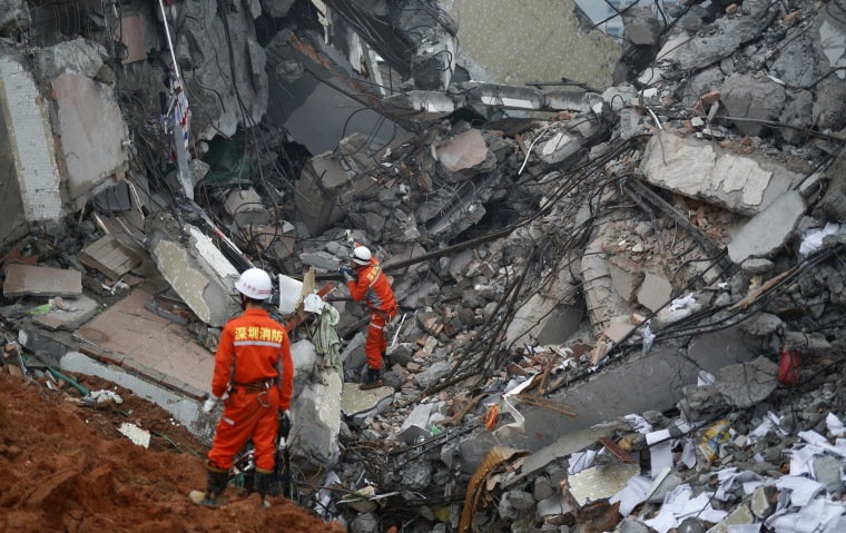 Image: Firefighters search for survivors among the debris of collapsed buildings after a landslide hit an industrial park in Shenzhen, Guangdong province, China